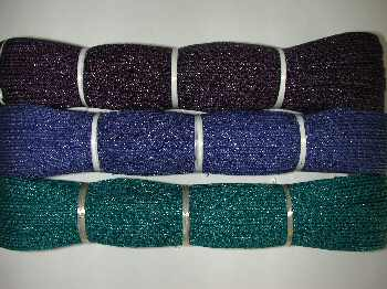 hanks of dark teal, royal blue and dark violet.